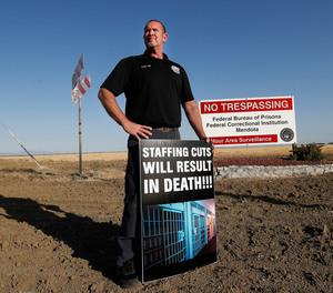 Aaron McGlothin, union president at the Federal Correctional Institution at Mendota, poses for a photo while leading a protest against staffing shortages, near the prison entrance in Mendota, Calif., Monday, May 17, 2021.