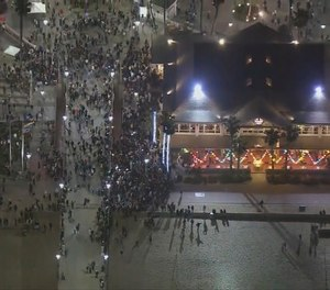 This Saturday, May 22, 2021 aerial screenshot provided by FOX 11 KTTV shows people gathered at the Huntington Beach pier in Huntington Beach, Calif.