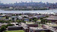9 NYC jail workers charged in bribery-contraband scam