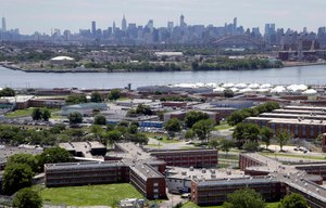 Nine COsand other employees, the majority working at the Rikers Island jail complex, were arrested on Wednesday for allegedly accepting bribes to smuggle in items including razor blades, drugs and alcohol.