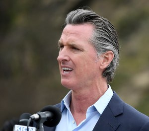 California Gov. Gavin Newsom has pardoned two inmates firefighters who were facing deportation to Laos.
