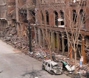 In this Dec. 29, 2020 file photo, a vehicle destroyed in a Christmas Day explosion remains on the street in Nashville, Tenn.