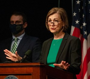 In this March 17, 2021 file photo, Gov. Kim Reynolds speaks during a news conference in a suburb of Des Moines, Iowa.