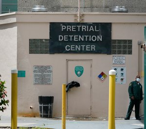 A corrections officer stands near a door at the Miami-Dade County Pre-Trial Detention Center, Friday, June 4, 2021, in Miami.