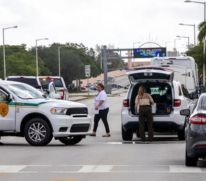 Police block an intersection near the Miami-Dade Kendall Campus in Miami, Fla., on Sunday, June 6, 2021. Three people are dead and at least six others injured following a shooting at a Florida graduation party, the latest in a string of such violence in the Miami area, police said Sunday.