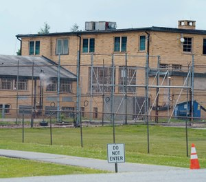 High fences surround buildings on the grounds of the Edna Mahan Correctional Facility for Women in Clinton, N.J., Tuesday, June 8, 2021.