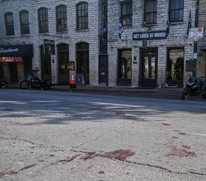 Blood stains remain on 6th Street after an early morning shooting on Saturday, June 12, 2021 in downtown Austin, Texas.