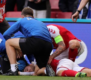 """Christian Eriksen, a midfielder for the Denmark national soccer team, suddenly collapsed during a European Championship match on Saturday and """"was gone"""" according to the team's doctor before being resuscitated, NBC News reported."""