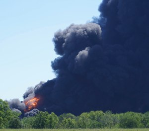 Flames and smoke are seen from an explosion at a chemical plant in Rockton, Ill.