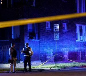 Police work the scene of a shooting in the East Garfield Park neighborhood on Tuesday June 15, 2021 in Chicago.