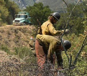 Firefighters work in steep terrain at the Willow Fire near Big Sur, Calif. Firefighters still face the difficult task of trying to contain a large forest fire in rugged coastal mountains south of Big Sur that forced the evacuation of a Buddhist monastery and nearby campground.