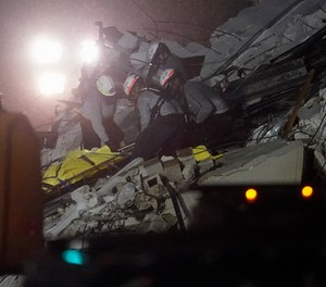 Raide Jadallah, an assistant Miami-Dade County fire chief, said that while listening devices placed on and in the wreckage had picked up no voices, they had detected possible banging noises, giving rescuers hope some are alive.