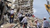 Fire hampers rescue effort amid rubble of Florida condo
