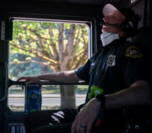 Salem Fire Department paramedic Justin Jones tries to stay cool after responding to a heat exposure call during a heat wave, Saturday, June 26, 2021, in Salem, Ore.