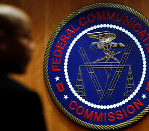 This Dec. 14, 2017, file photo, shows the seal of the Federal Communications Commission (FCC) before a meeting in Washington.