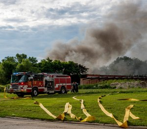 Firefighters work the scene of an industrial fire Tuesday, June 29, 2021, in Morris, Ill. Lithium batteries have been noisily exploding inside a burning abandoned paper mill in northern Illinois and firefighters are letting the blaze burn out because they fear trying to extinguish it could trigger more explosions, officials said Wednesday.