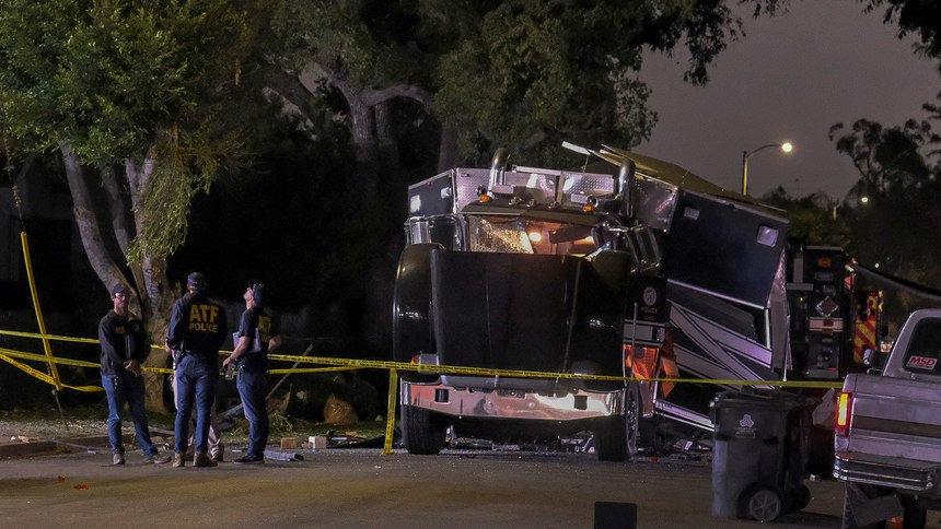 The remains of an armored Los Angeles Police Department tractor-trailer are seen after fireworks exploded Wednesday evening, June 30, 2021.