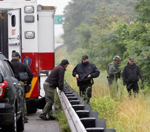 Police work in the area of an hours long standoff with a group of armed men that partially shut down interstate 95, Saturday, July 3, 2021, in Wakefield, Mass.