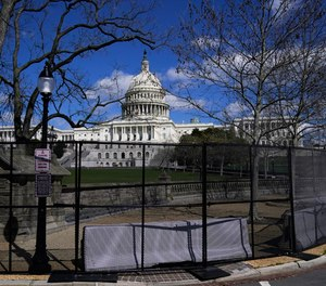In this April 2, 2021, file photo the U.S. Capitol is seen behind security fencing on Capitol Hill in Washington.