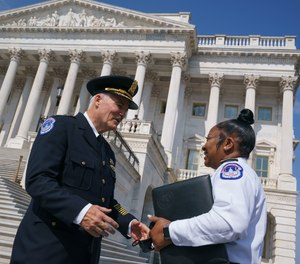 J. Thomas Manger, a veteran police chief of departments in the Washington, D.C., region, is welcomed by Acting Chief Yogananda Pittman as he takes over the United States Capitol Police on July 23, 2021.