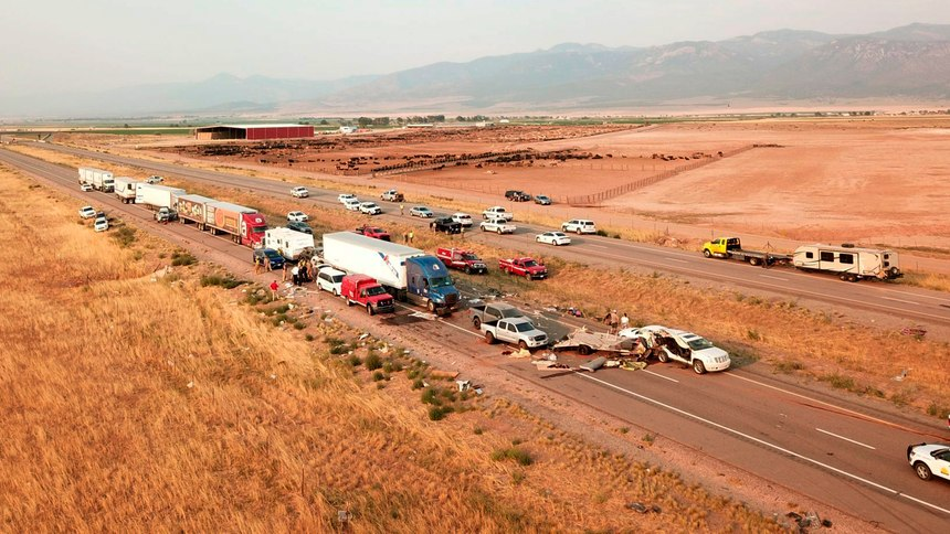 This photo provided by the Utah Highway Patrol and posted on the Utah Department of Public Safety website shows the scene of a fatal pileup, Sunday, July 25, 2021, on Interstate 15 in Millard County, near the town of Kanosh, Utah.