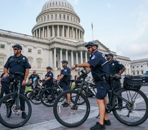 U.S. Capitol Police Mountain Bike officers secure the plaza near the steps of the Capitol in Washington, Thursday, July 29, 2021.