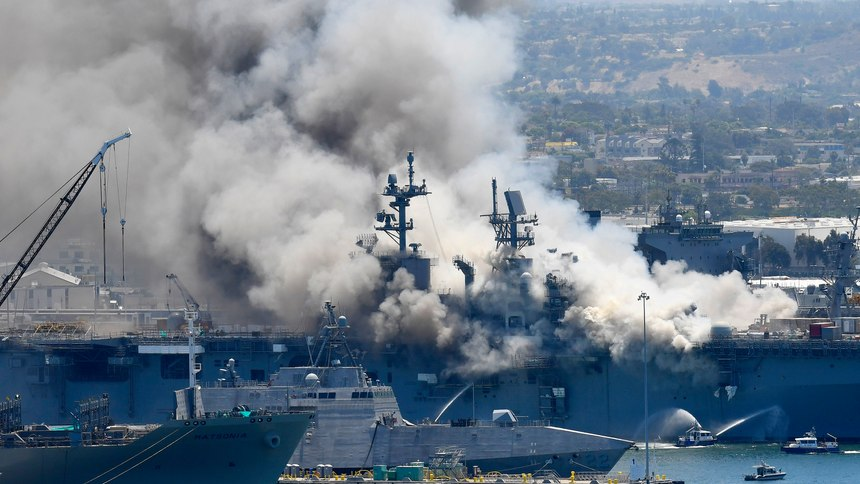 Smoke rises from the USS Bonhomme Richardafter an explosion and fire onboard the ship at Naval Base San Diego in July 2020.