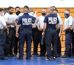 Baltimore city police instructors speak to police trainees during defense tactic training, Wednesday, Aug. 4, 2021, in Baltimore.