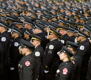 Chicago police and firefighters salute as the body of slain Chicago police officer Ella French is carried into the St. Rita of Cascia Shrine Chapel for a funeral service Thursday, Aug. 19, 2021, in Chicago.