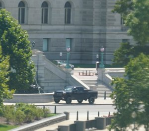 A pickup truck is parked on the sidewalk in front of the Library of Congress' Thomas Jefferson Building, as seen from a window of the U.S. Capitol, Thursday, Aug. 19, 2021, in Washington.