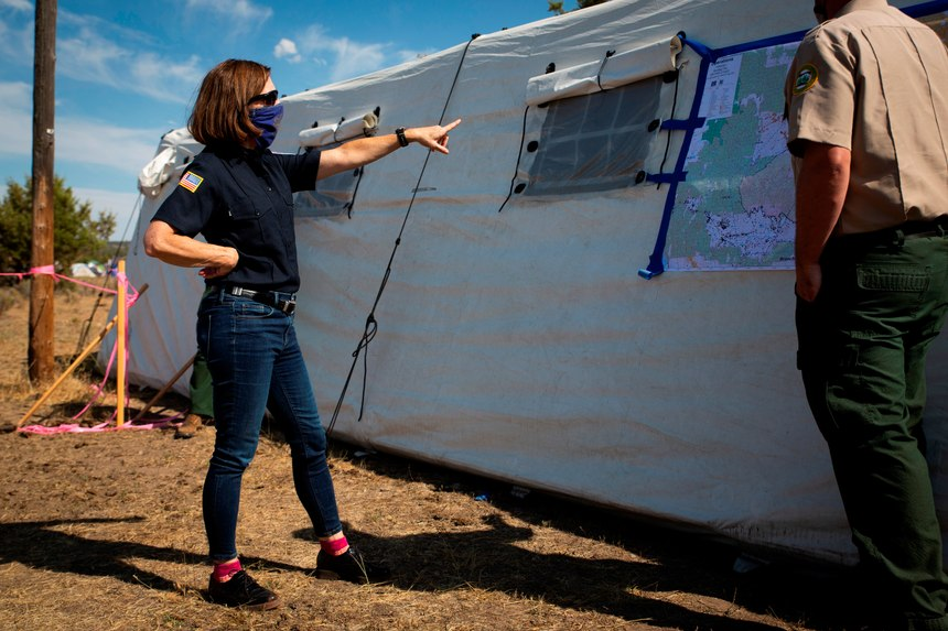 Oregon Gov. Kate Brown, left, visits the Bly Fire Camp, on the southern edge of the Bootleg Fire, in Klamath County, Ore.