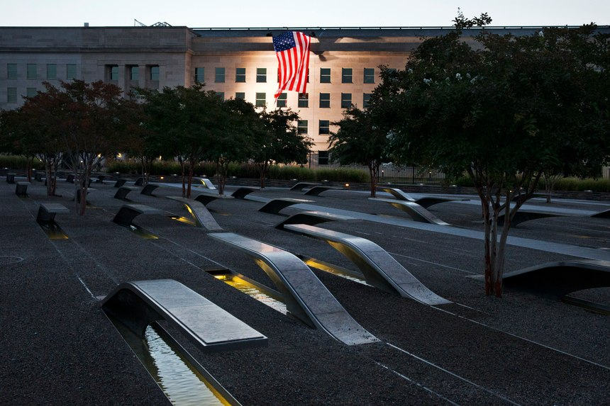 A U.S. flag is draped on the side of the Pentagon where the attack took place, seen from the Pentagon Memorial.