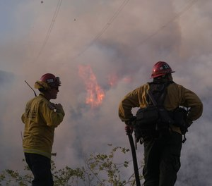 Firefighters watch as the South Fire burns in Lytle Creek, San Bernardino County, north of Rialto, Calif., Wednesday, Aug. 25, 2021.