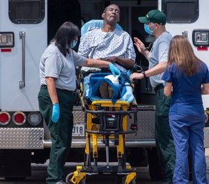 Ambulances and buses transported nursing home residents who were evacuated to an over-crowded warehouse before Hurricane Ida.