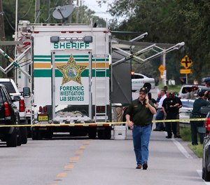 Polk County, Fla., Sheriff's officials work the scene of a multiple fatality shooting Sunday, Sept. 5, 2021, in Lakeland, Fla. Four people are dead including a mother who was still cradling her now deceased baby in what Florida sheriff's deputies are calling a massive gun battle with a suspect.