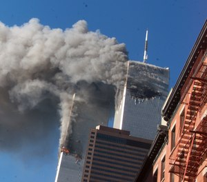 Smoke rises from the burning twin towers of the World Trade Center after hijacked planes crashed into the towers on September 11, 2001 in New York City.