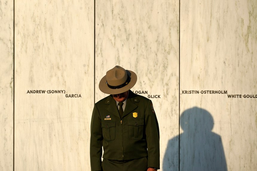 A National Park Service ranger stands in front of the Wall of Names at the Flight 93 National Memorial in Shanksville, Pa. before a Service of Remembrance Saturday, Sept. 11, 2021, as the nation marks the 20th anniversary of the Sept. 11, 2001 attacks.