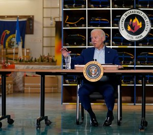 President Joe Biden greets firefighters as he tours the National Interagency Fire Center, Monday, Sept. 13, 2021, in Boise, Idaho.