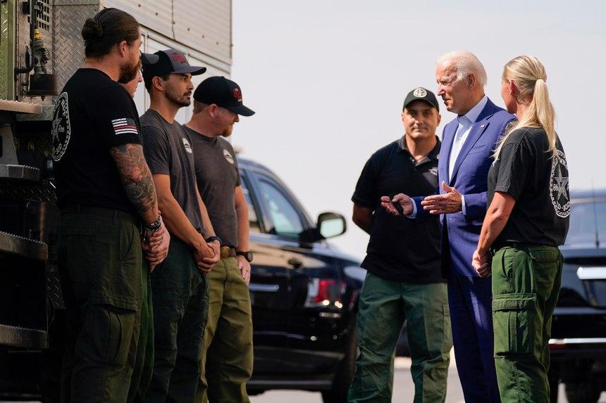 President Joe Biden greets firefighters as he tours the National Interagency Fire Centerin Boise, Idaho.
