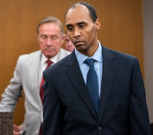 In this June 7, 2019 file photo, former Minneapolis police officer Mohamed Noor walks to the podium to be sentenced at Hennepin County District Court in Minneapolis.