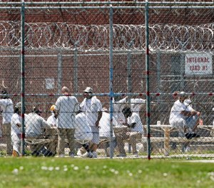 In this June 25, 2020, photo, prisoners populate a yard at the Nebraska State Penitentiary in Lincoln, Neb.