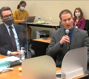 In this April 15, 2021, file image from video, defense attorney Eric Nelson, left, and defendant, former Minneapolis police Officer Derek Chauvin, address Hennepin County Judge Peter Cahill at the Hennepin County Courthouse in Minneapolis.