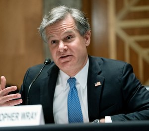 FBI Director Christopher Wray testifies before a Senate Homeland Security and Governmental Affairs Committee hearing to discuss security threats 20 years after the 9/11 terrorist attacks, Tuesday, Sept. 21, 2021 on Capitol Hill in Washington.