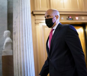 Sen. Cory Booker, D-N.J., arrives at the Senate chamber at the Capitol in Washington, Wednesday, Sept. 22, 2021, after bipartisan congressional talks on overhauling policing practices ended without an agreement.