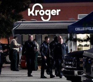 Law enforcement personnel work in front of a Kroger grocery store as an investigation goes into the night following a shooting earlier in the day on Thursday, Sept. 23, 2021, in Collierville, Tenn.