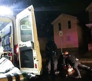In this image taken from police body camera video, Rochester police officers hold down Daniel Prude on March 23, 2020, in Rochester, N.Y.