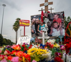 in this Sept. 10, 2020 file photo, a tribute to Nicolas Chavez, 27, who was shot and killed April 21, 2020, by several police officers during a confrontation in Denver Harbor, sits at the site of the shooting along Interstate 10, in Houston.