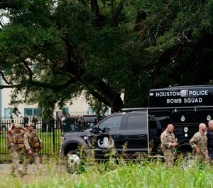 Police gather at YES Prep Southwest Secondary school after a shooting on Friday, Oct. 1, 2021 in Houston.
