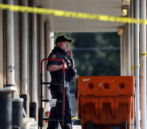 Memphis Police Department officers work the scene of a post office after a shooting, Tuesday, Oct. 12, 2021 in the Orange Mound neighborhood of Memphis, Tenn.