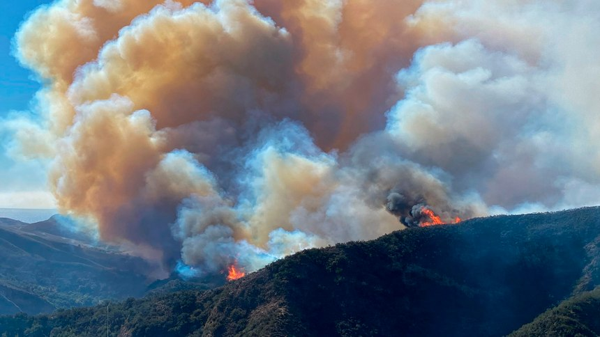 In this photo provided by Santa Barbara County Fire Department, the Alisal Fire continues to burn the dry vegetation in Refugio Canyon on Tuesday morning, Oct. 12, 2021, in Santa Barbara County, Calif.